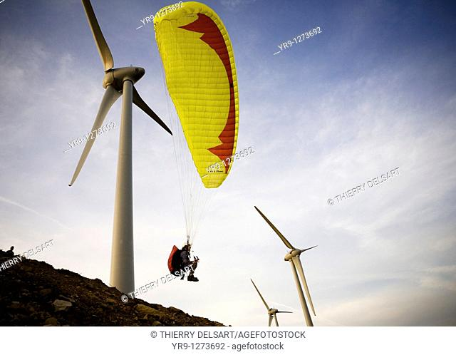 A paraglider is taking off in between the wind turbines, what would be totally insane if these would be in service: It was while the installation of this...