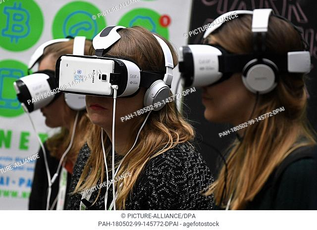 02 May 2018, Germany, Berlin: Young women in VRglasses at the internet conference re:publica. The conference on digital soicety is taking place together with...