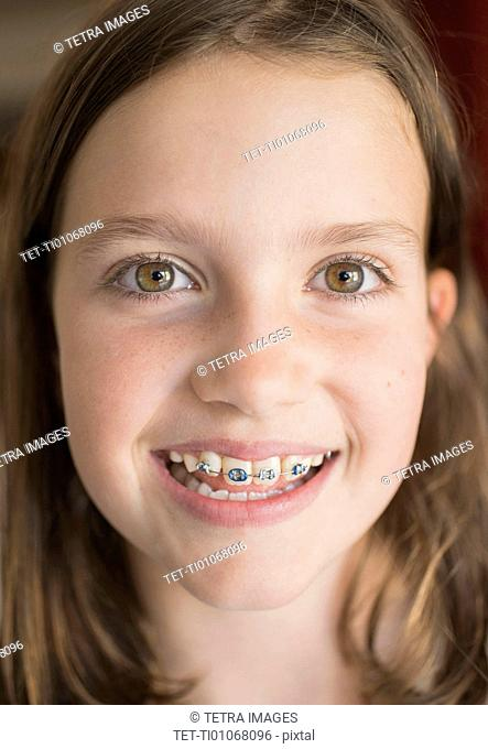 Girl (8-9) showing braces