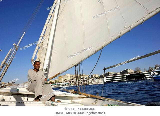 Egypt, Upper Egypt, Aswan, young fisherman in a felucca on the Nile near the city center