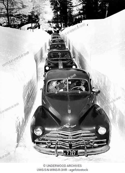 Idaho: c. 1952.It's slow going through a plowed cut in the mountains of Idaho