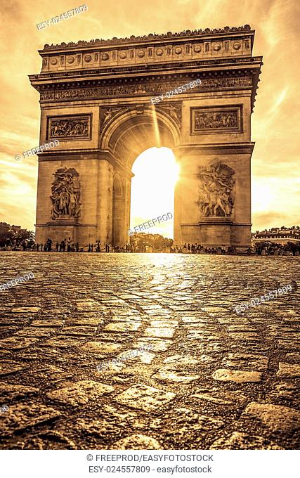 Beautiful sunset over Arc de Triomphe at Place de l'Etoile, Paris, France