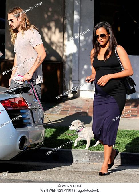 Pregnant Zoe Saldana shops for baby supplies at Bel Bambini on Robertson Boulevard with her husband Marco Perego and their adopted shelter dog Mugsy