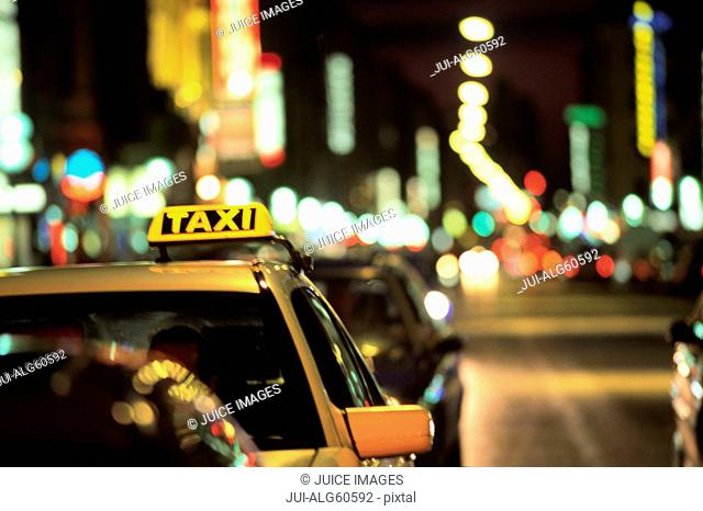 Taxi cab and traffic at night