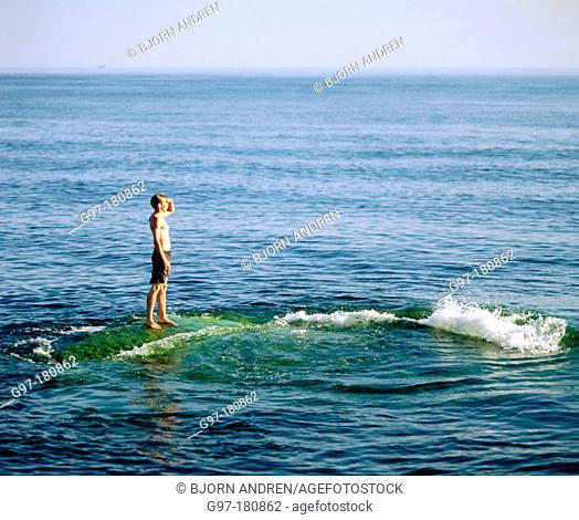 Boy on shoal. Sweden