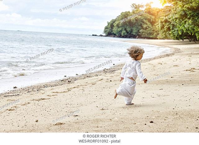 Thailand, Ko Yao Noi, little girl running on the beach