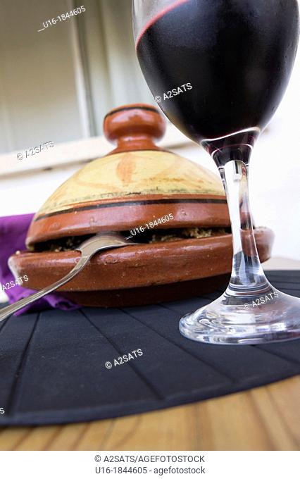 Tajin Arab dish with a glass of wine