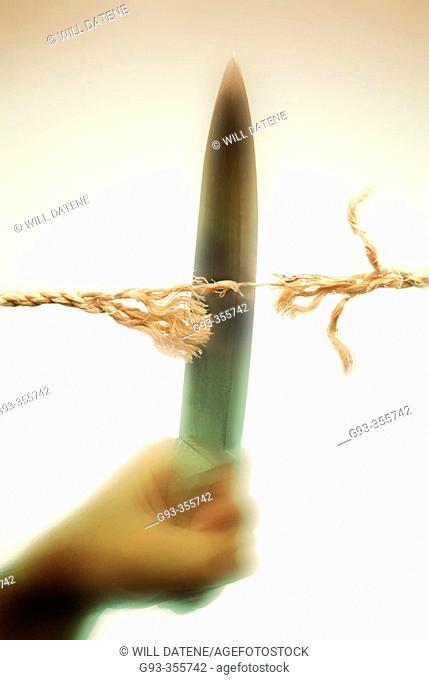 Knife cutting rope