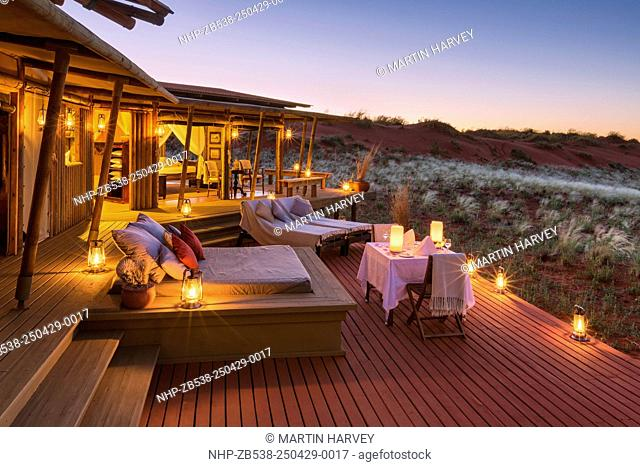 Romantic dining on deck area of mountain view suite.Dunes lodge.Wolwedans NamibRand Nature Reserve.Namibia