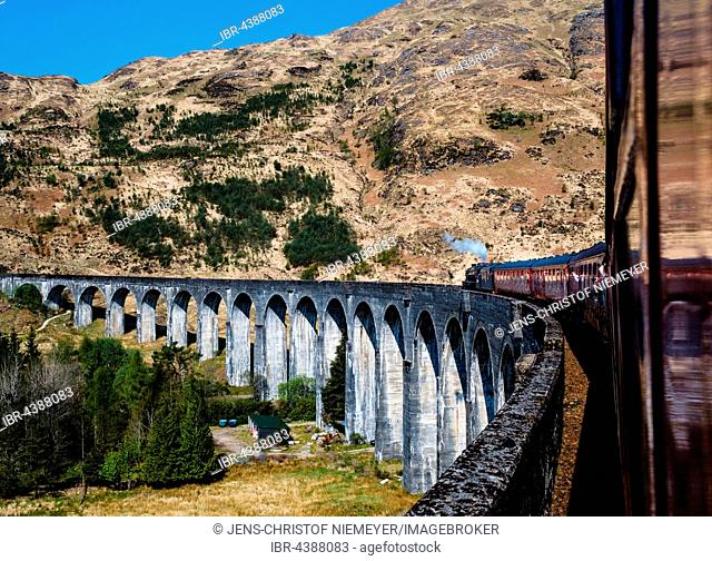 Vintage train The Jacobite Steam Train driving over the Glenfinnan Viaduct, Glenfinnan, Highland, Scotland, United Kingdom