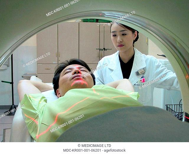 A patient undergoes a CT scan under care of staff at the Samsung Medical Center