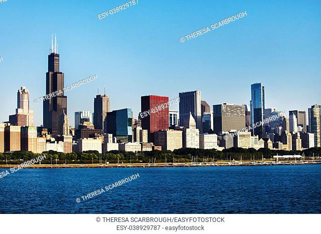 Partial view of Chicago skyline over Lake Michigan early morning