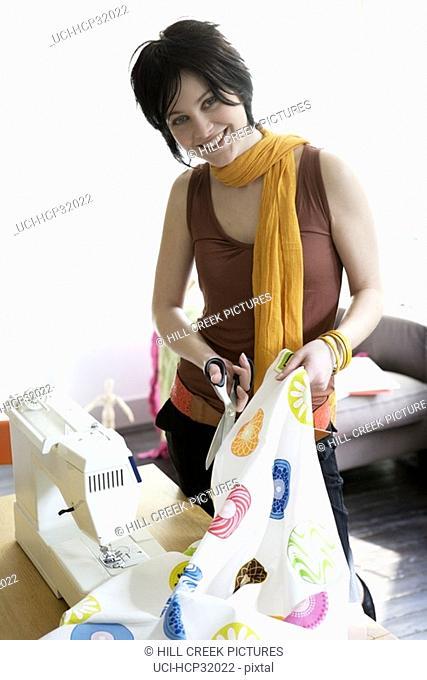 Seamstress cutting fabric