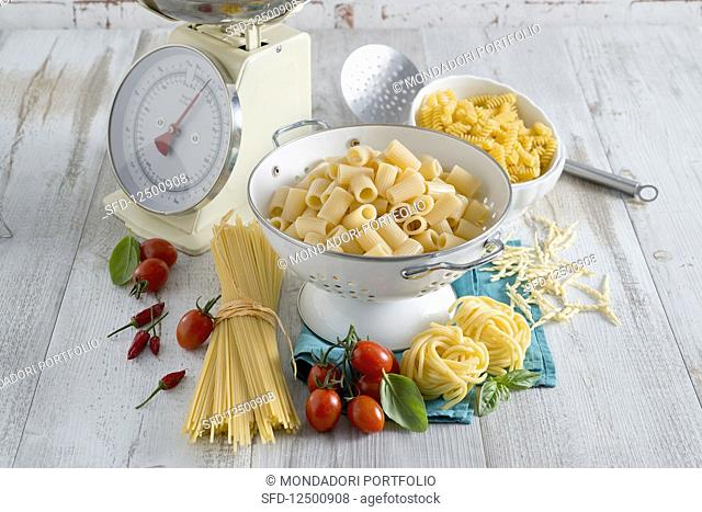 An arrangement of pasta with a pair of scales