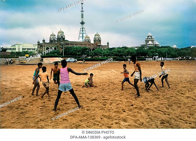 Children Playing at Marina beach ; Chennai ; Tamil Nadu ; India