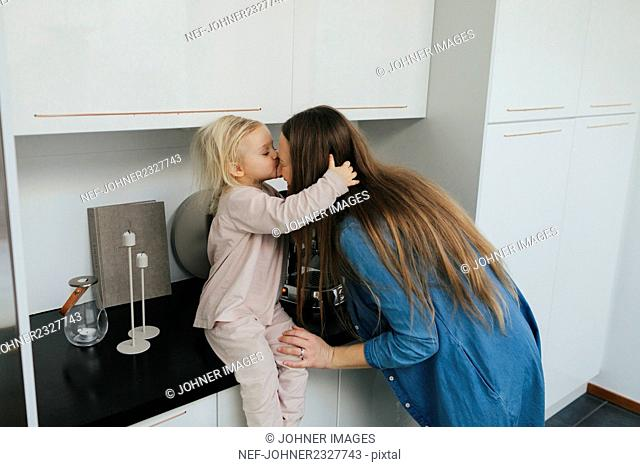 Mother with daughter kissing