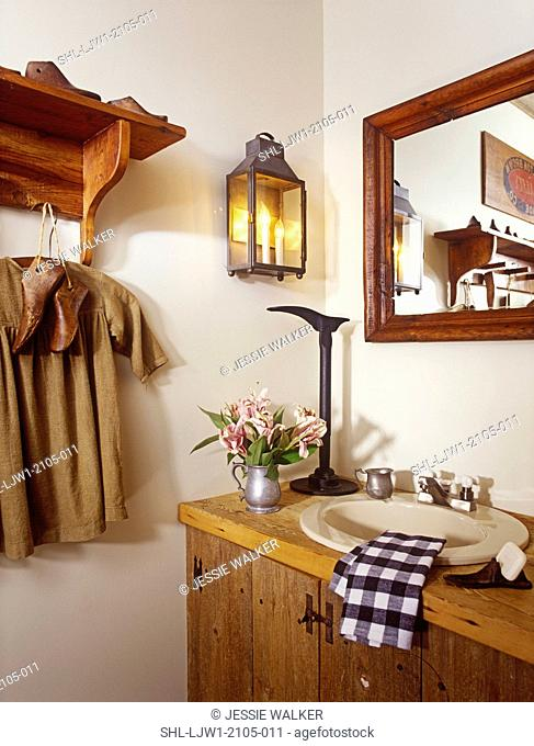 BATHROOMS: Sink in rustic wood vanity, antique lantern as wall sconce, wood mirror, wood shelf, antique childs shirt and wooden shoe stretchers hang from peg