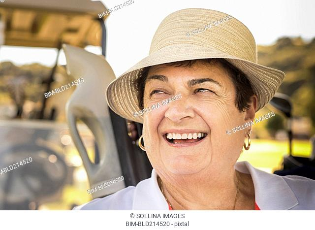 Close up of smiling older woman wearing hat