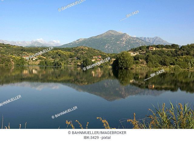 Near Ivrea Piedmont Piemonte Italy Lago Sirio morainic morainial landscape lake in the background the Gran Paradiso National Park