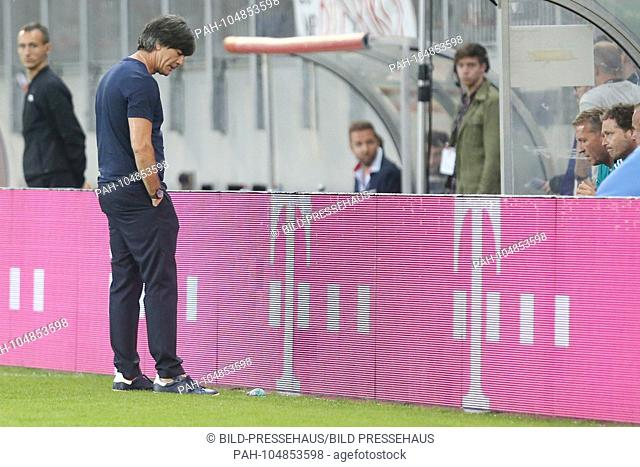 Bundescoach Joachim Jogi Low, Loew (Germany) with lowered head at the band, Austria - Germany, last test match before the final nomination of the squad for the...