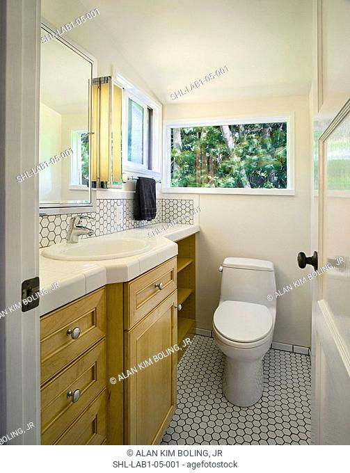 Traditional half bath with white tile