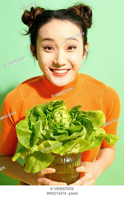 Young women and vegetables