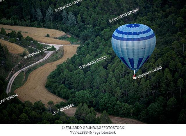 Ballooon flying over wheat field in European hot air balloon festival Igualada, Barcelona, Catalonia, Spain, Europe