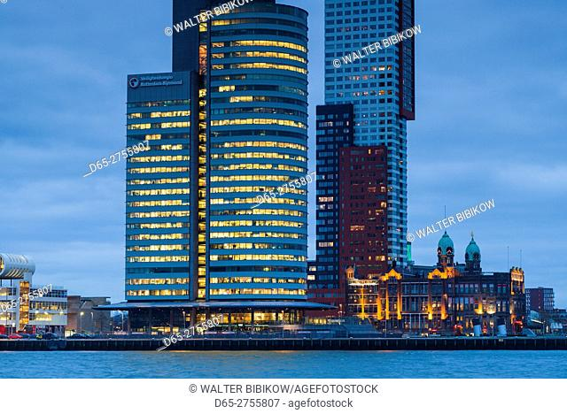 Netherlands, Rotterdam, new commerical towers at the renovated docklands, dawn