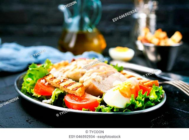 salad with baked chicken fillet, salad on plate