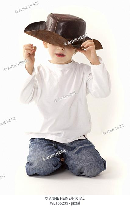 boy with hat over face,white background