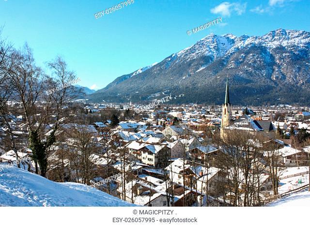 garmisch-partenkirchen - partenkirchener townscape in winter with church and mountain views