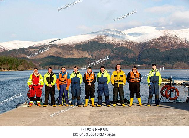 Workers smiling together on salmon farm