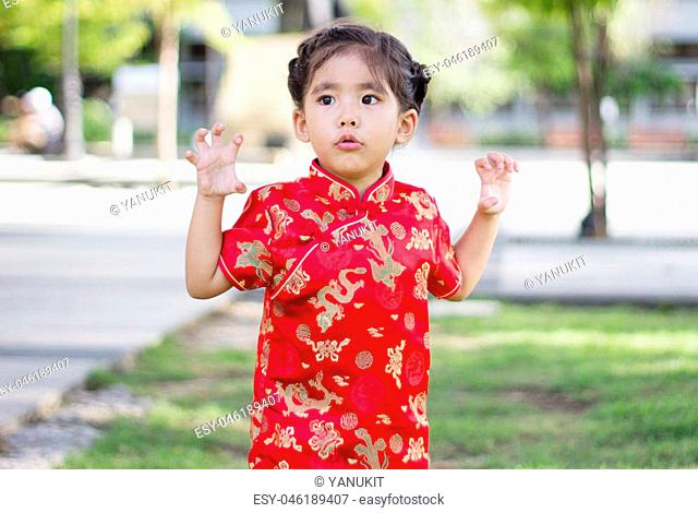 close up asian Chinese girl in red dress action funny tiger
