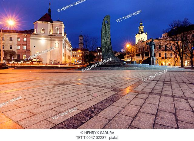 Town square at night in Lviv, Ukraine