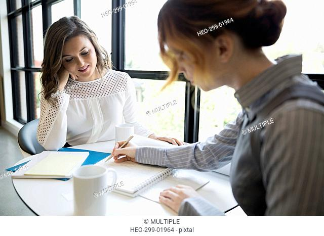 Businesswomen brainstorming at office table