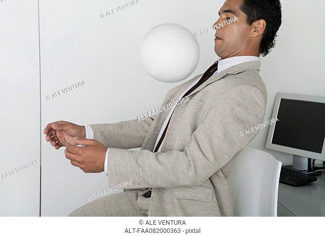 Man playing with ball in office