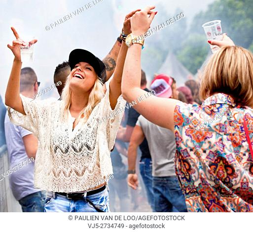 Beek en Donk, Netherlands, Two girls dancing and laughing at an event