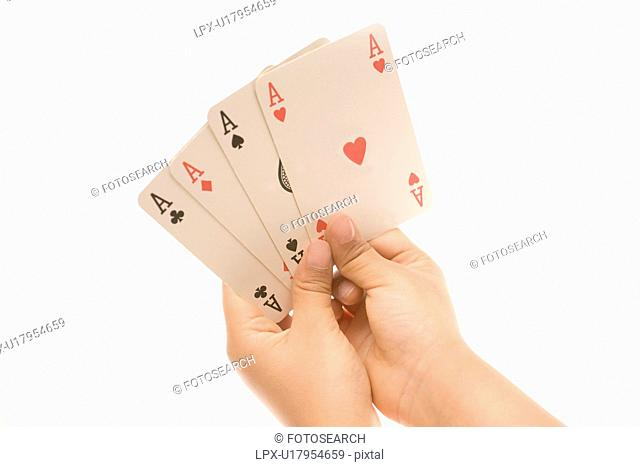 Child holding cards