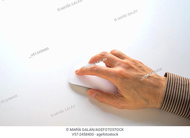 Man's hand using computer mouse