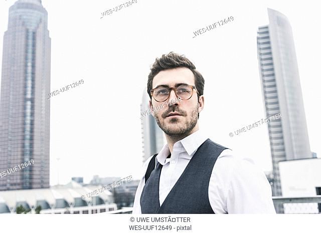 Germany, Frankfurt, portrait of young businessman in the city