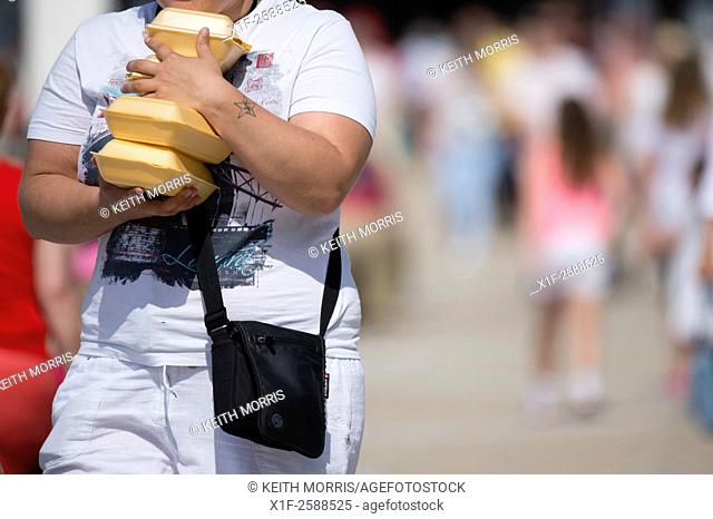 Unhealthy diet: A woman with her arms full of take-away food containers