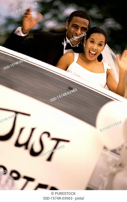 Newlywed couple waving