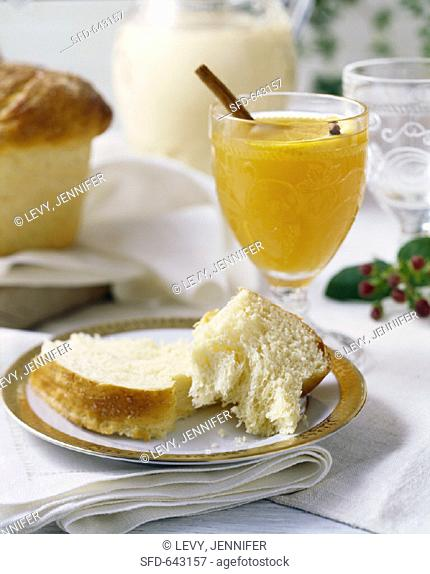 Brioche and glass of orange juice