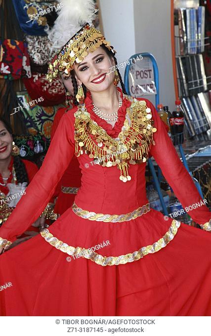 Uzbekistan, Khiva, young woman, traditional dress,