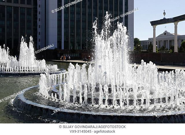 Tashkent, Uzbekistan - May 12, 2017: View of Independence Square, gate of independence and fountains, a famous landmark in the city and a major tourist...