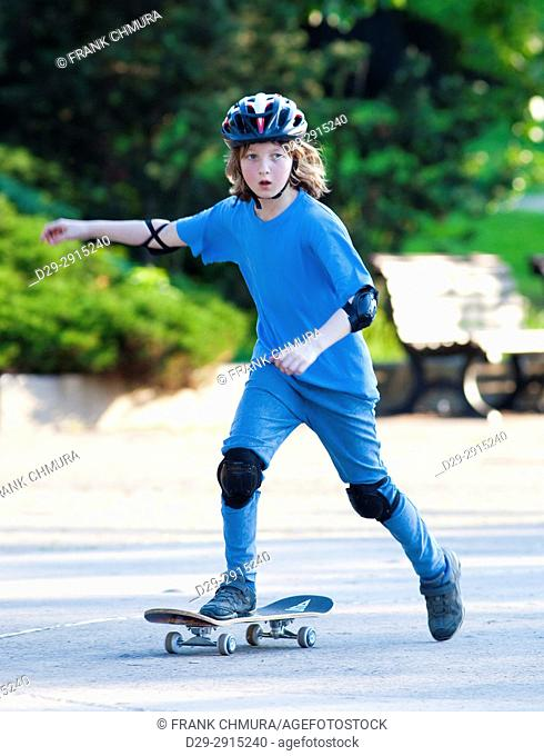 Skateboarding - Boy with Blond Hair Learning to Skateboard.