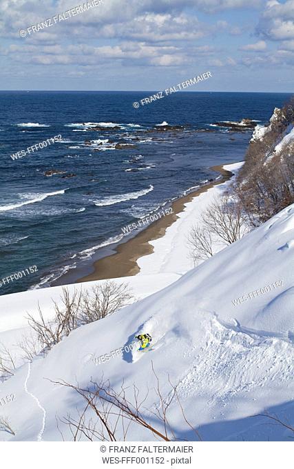 Japan, Hokkaido, Man doing telemark skiing