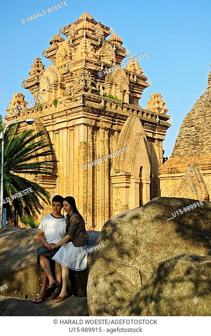 Asia, Vietnam, Nha Trang  Po Nagar Cham Towers  A young vietnamese couple posing for a photograph  The Cham Towers dating back to the 7-12 century are located...