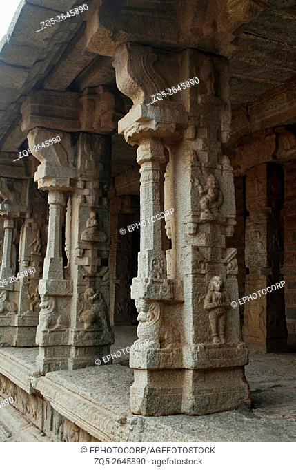 Carved pillars of the inner courtyard, cloisters or pillared verandah, Achyuta Raya temple, Hampi, Karnataka, India. Sacred Center