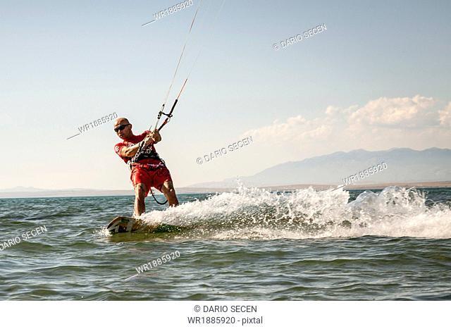 Croatia, Man kite surfing at high speed